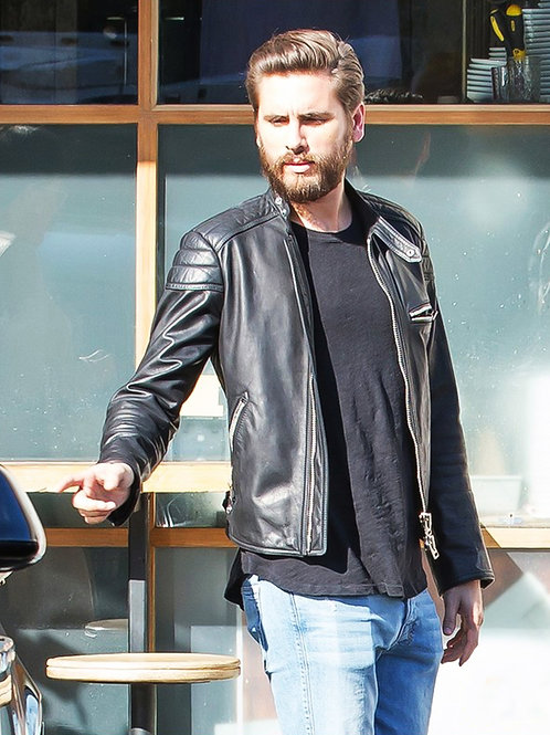 Scott Disick Pointing at a Car