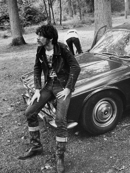 Bulging Jean Pierre Sitting on a Jaguar