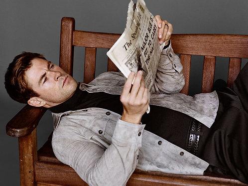 Chris Hemsworth Reading a Newspaper