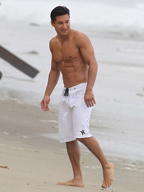 Mario Lopez on the Beach Bulging in his White Boardshorts