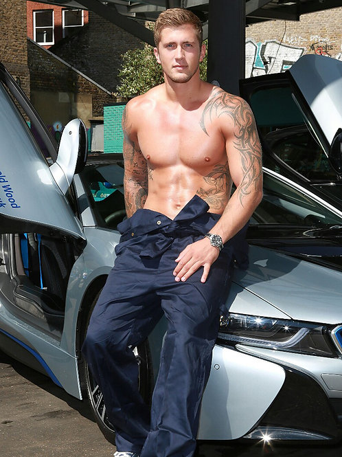 Shirtless Dan Osborne Leaning on a BMW i8 Fender