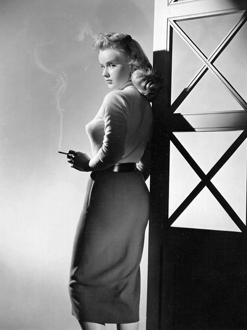 Anne Francis Smoking Wearing a Tight Sweater & skirt