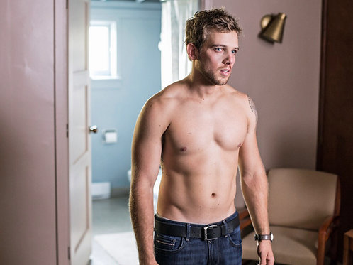Shirtless Max Thieriot in a Scene from Bates Motel