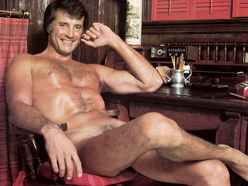 Nude Lyle Waggoner Sitting at his Desk with his Legs Crossed