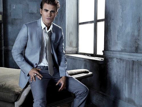Actor Paul Wesley Sitting on a Bed