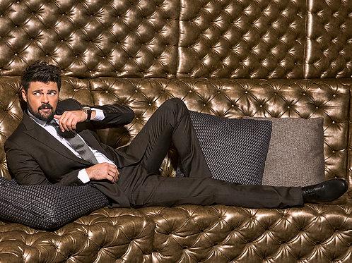 Karl Urban on a Tufted Sofa