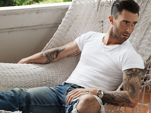 Bulging Adam Levine Wearing Torn Jeans Relaxing in a Hammock