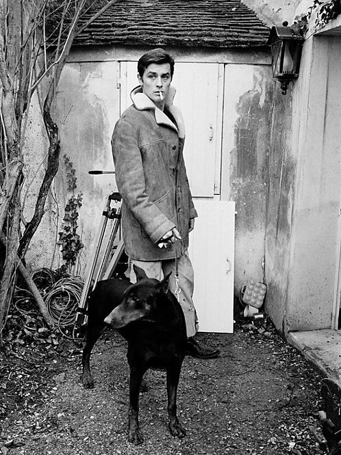 Alain Delon with a Black Dog