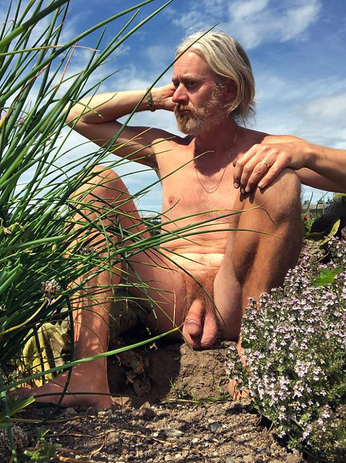 Blonde Man Sitting in his Garden