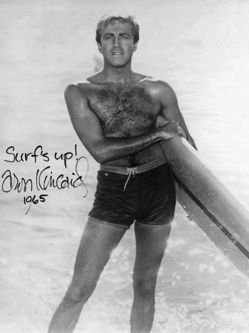 Aron Kincaid Shirtless with a Surfboard in 1965