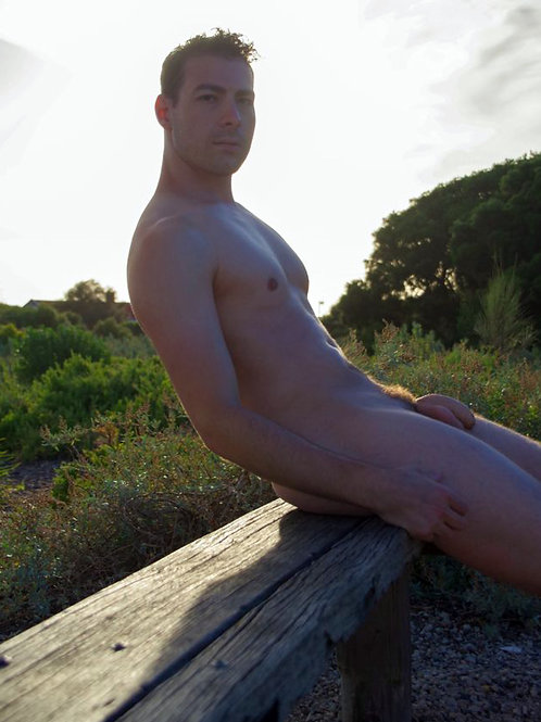 Nude Dude Sitting on a Rough Bench