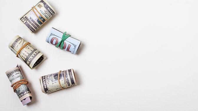 money-tied-with-elastics-copy-space.jpg