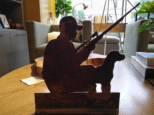 Escultura cazador y perro en hierro