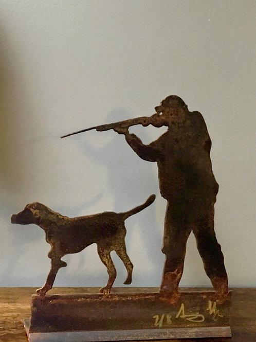 Escultura cazador con perro
