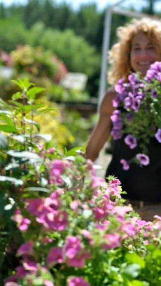 woman with greenhouse flowers