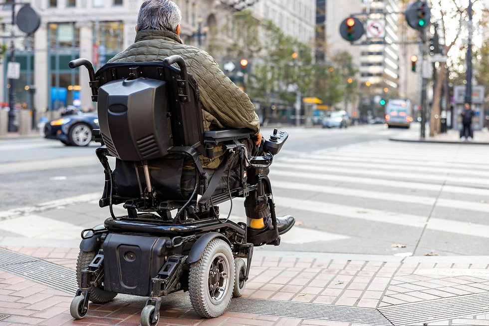 An elderly disabled person on an electri