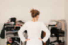 clutter-depression-woman-wardrobe-standa