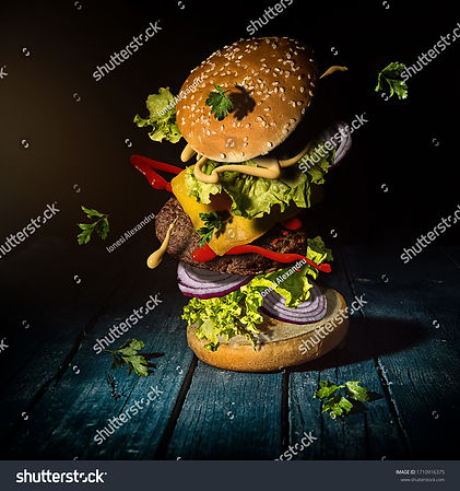 stock-photo-burger-with-flying-ingredien