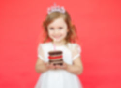 Little girl wearing crown holding a birt