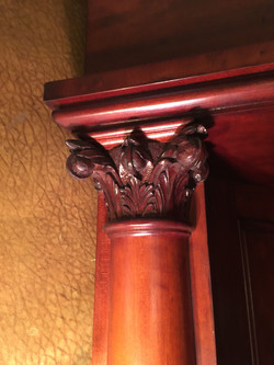 Capital on fireplace column