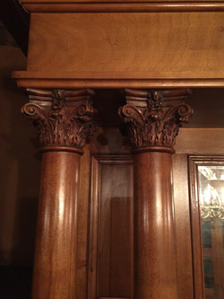 Capitals on hallway columns