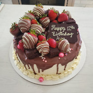 Garnished with chocolate covered strawberries and brownies.