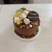 Garnished with meringues, and macarons.