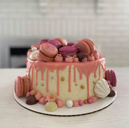 Garnished with meringues, macarons and chocolate bonbons.