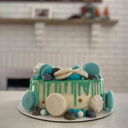 Garnished with meringues, french macarons and chocolate bonbons (additonal cost)