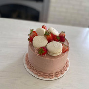 Garnished with strawberries and macarons.