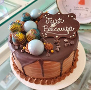 Garnished with our chocolate bonbons and a ganache