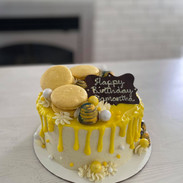Garnished with macarons and bonbons.
