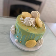 Garnished with meringues and macarons