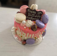 Garnished with meringues, french macarons and chocolate bonbons