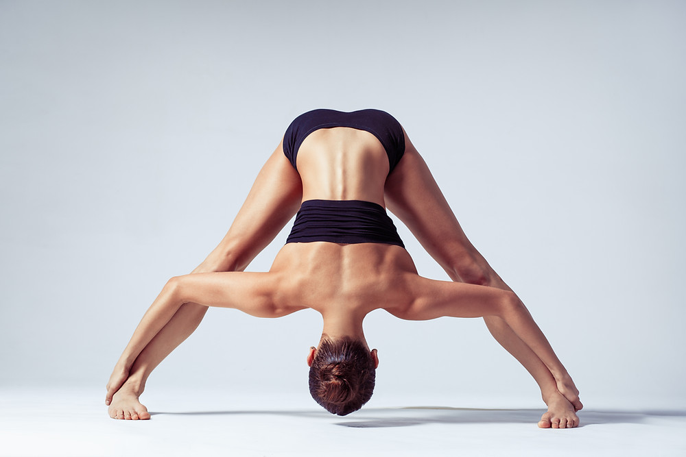 woman holding a yoga stretch position