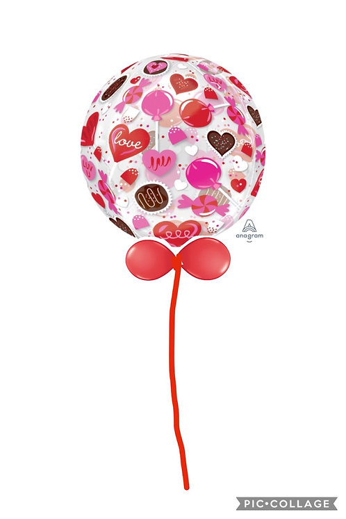 Candy Large Orbz balloon finished with a balloon collar