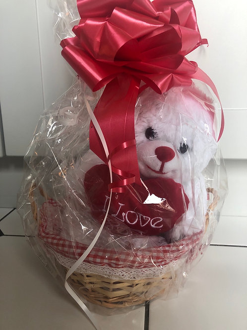 White plush Bear 10inch in basket with Valentine balloon attached.