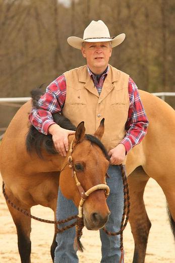 Arnulf with buckskin mare head down in b
