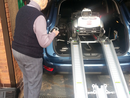 Mrs Boon loading her all new self-lifting mobility scooter the Quingo Flyte into her Citroen Picasso