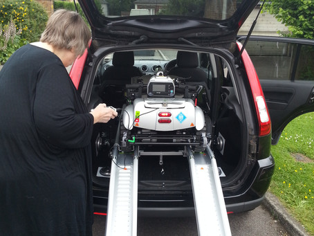 Mrs Lucas finding out easy it is to load the all new portable mobility scooter the Quingo Flyte
