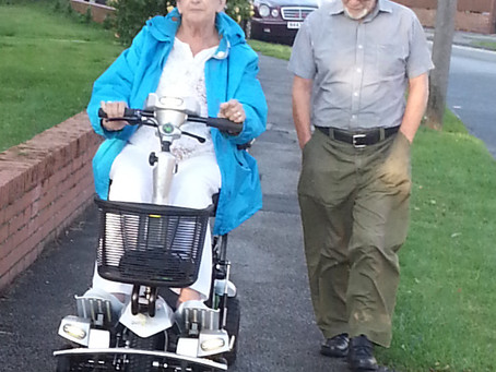 Mrs Marriott getting to grip with her all new self-lifting portable mobility scooter the Quingo Flyt