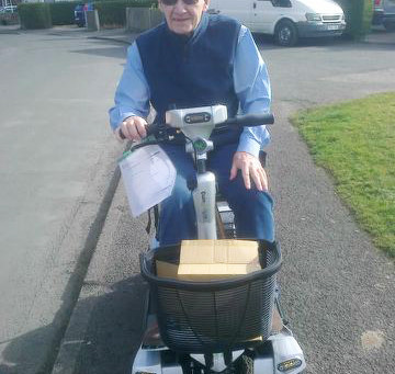 Mr Eldridge on his all new portable self-lifting mobility scooter the Quingo Flyte
