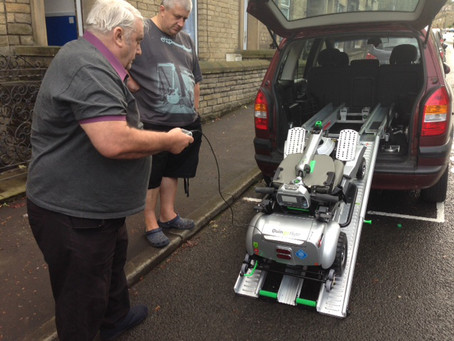 Mr Whatmough loading up his all new self-lifting portable mobility scooter the Quingo Flyte