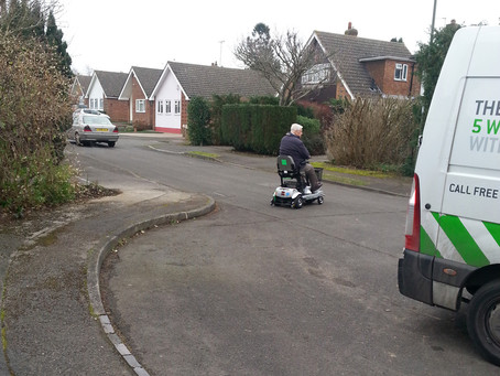 Mr Benke enjoying a test ride with all new portable mobility scooter the Quingo Flyte