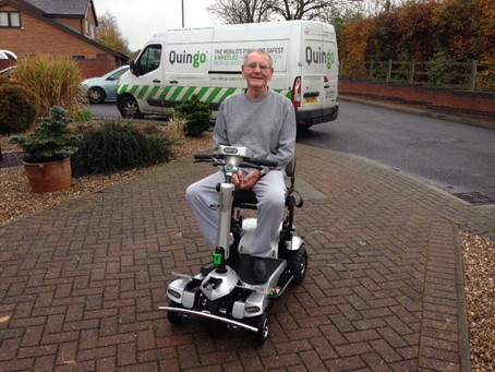 Mr Knowles in his all new self-lifting portable mobility scooter the Quingo Flyte