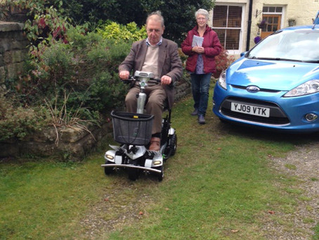 Mr & Mrs Bloomer having a free no obligation test drive and loving the Quingo Flyte the self lifting
