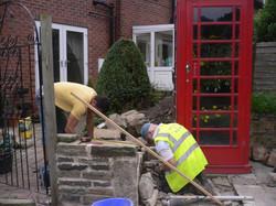 Walling around the telephone box