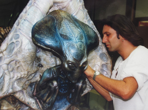 Production Designer Patrick Tatopoulos with alien