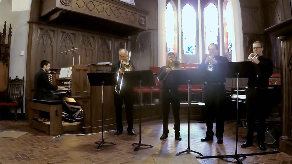 Brass Quartet and organist perform in traditional church sanctuary
