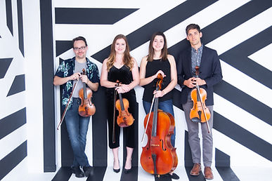 String Quartet poses in front of stripe design